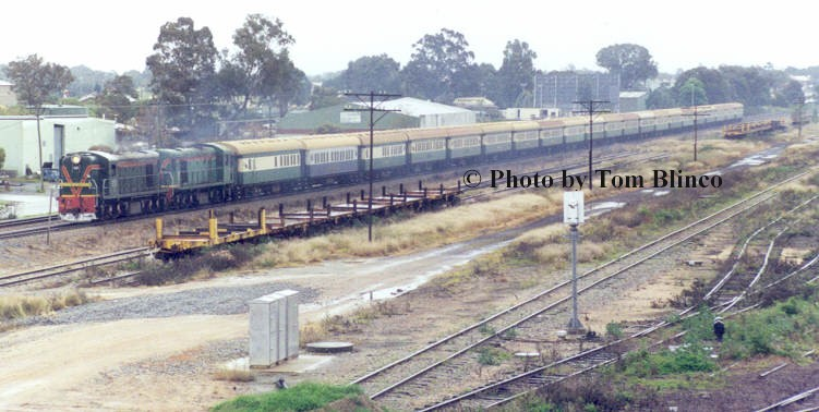 21 coach Avon Descent train with rarely seen double headed C class diesel electric locomotives rolls towards the Robinson Rd crossing whilst passing through the remains of Midland yard.